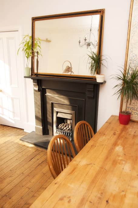 Living room- lovely fireplace and a big table to eat meals at!