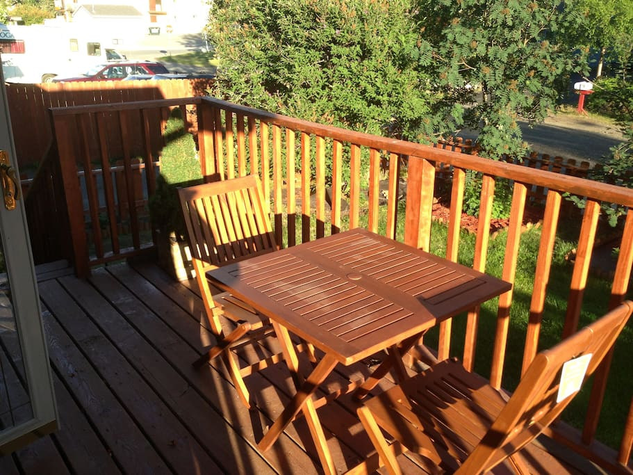 The front Deck is a great place to relax, read a book, or have a late dinner under the Midnight Sun!