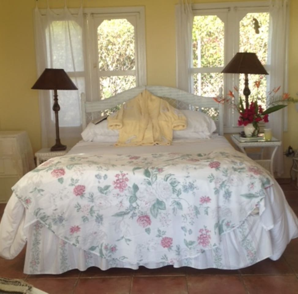 Airy Queen Bedroom has view to the Caribbean Sea from the slope of the volcano, Nevis Peak. About 750' high.