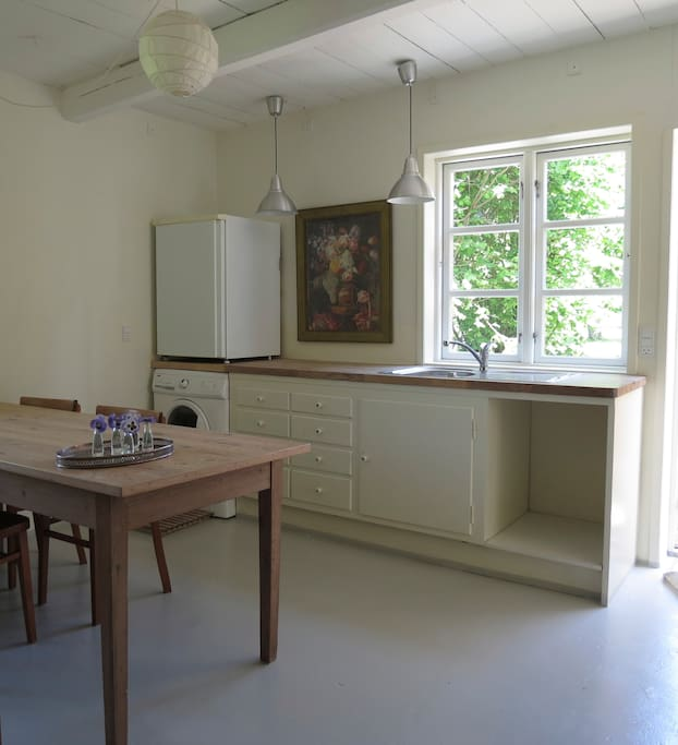 The kitchen with view to the apple garden.