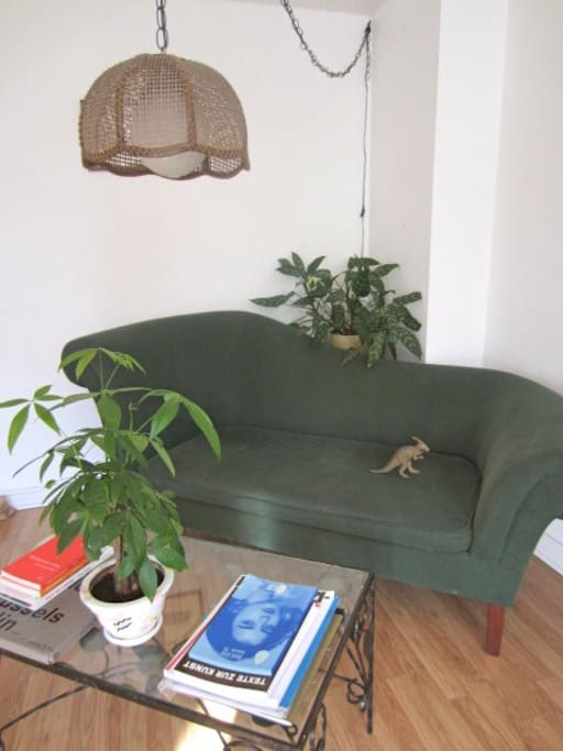 lay down on this couch and read your newspaper that you got from the dépanneur across the street.