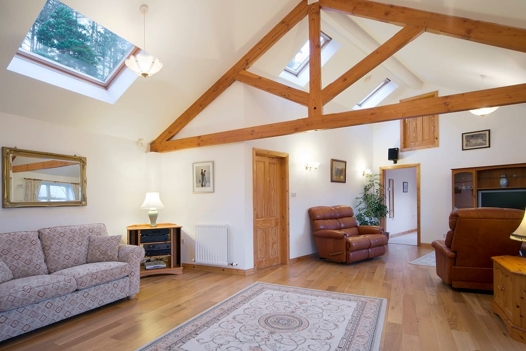 Solid oak floors and leather reclining arm chairs. Great woodland views from the sky lights.