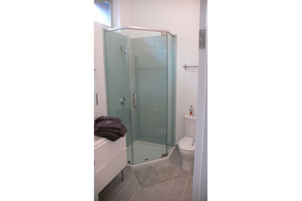 bathroom with shower and heated floors towels provided