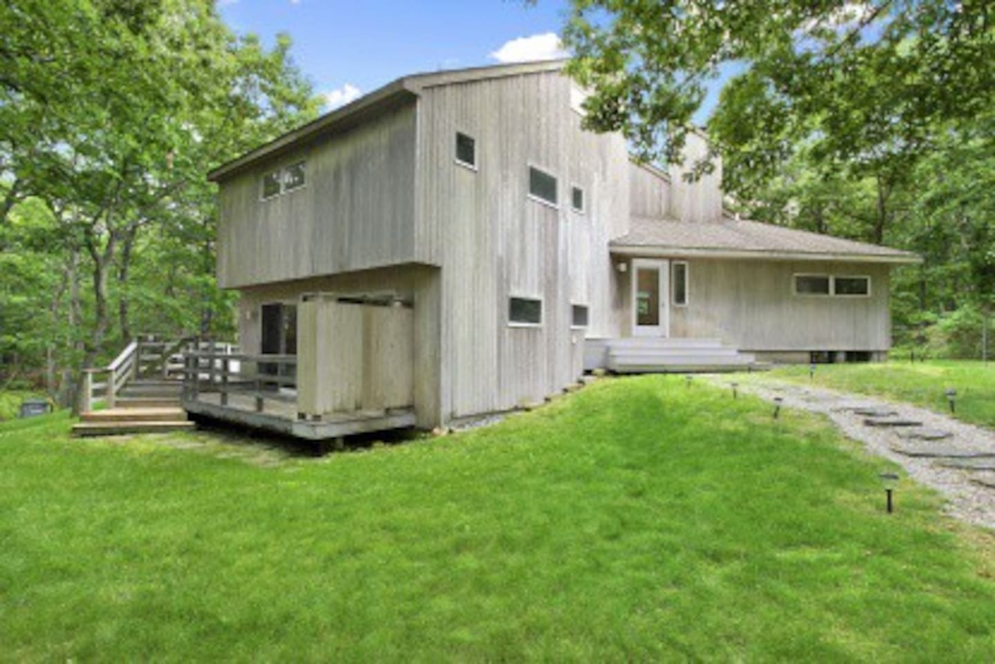 Front of the home, situated on .75 acres adjacent to a forest preserve.