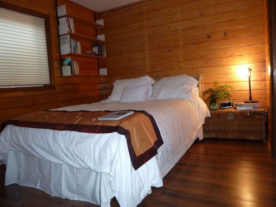 This bedroom is most unique with the wood walls. It is closest to the bathroom.