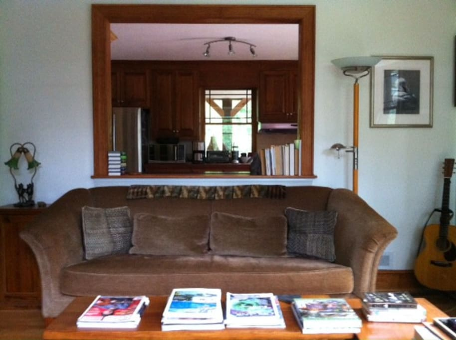 Looking into kitchen and writing studio beyond (through distant window) from great room pass-thru