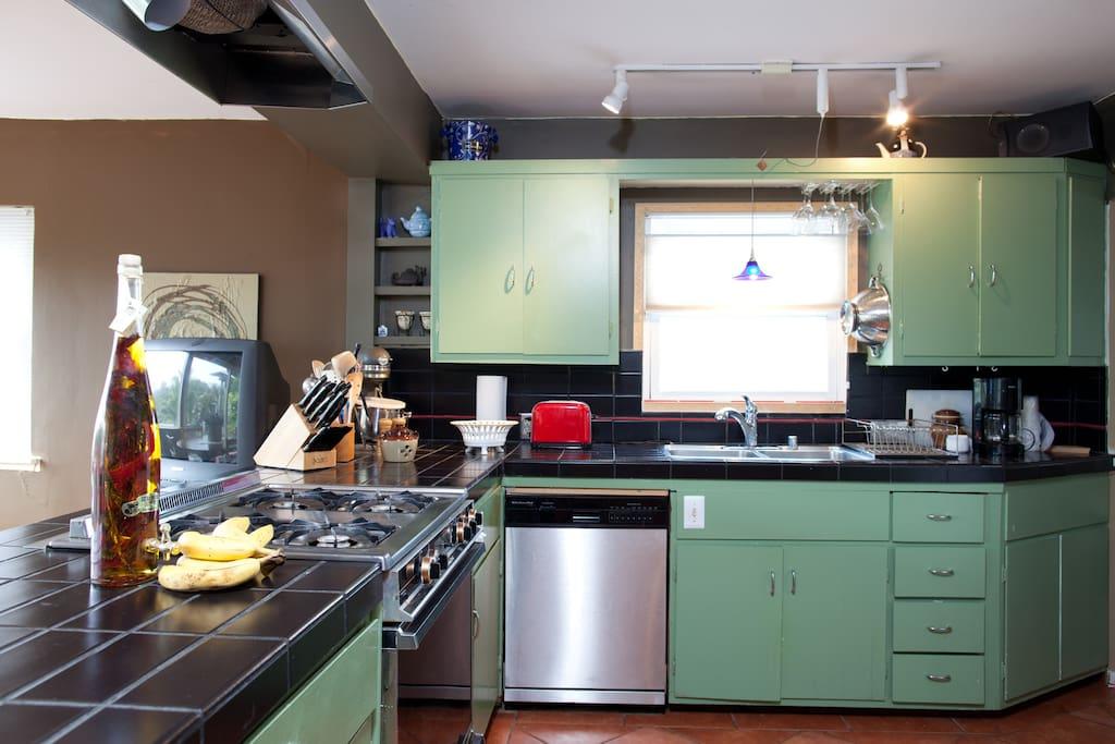 Kitchen, dishwasher, gas range and oven