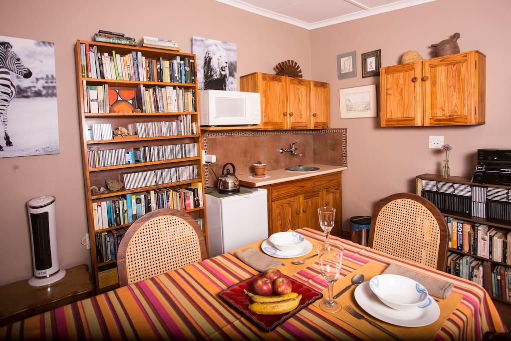Kitchenette and dinning area with an eclectic collection of books and music