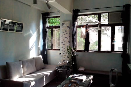 We located at quite & characters area but only take you 10mins walk to busy Soho area. Our neighbor is nice& friendly, lot of cool shops on Po Hing Fong and Tai Ping Shan St. and outside your flat have a yoga studio and healthy veggie cafe.