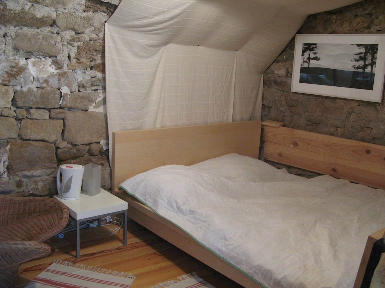 Cool and cosy room for two. Possibility to add a baby / child mattress.