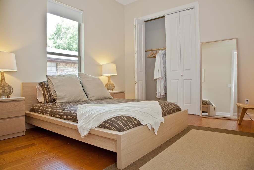 Bedroom 2 - Queen-size pillow-top mattress with luxury linens, plush bath robes, full-length mirror, and large closet.