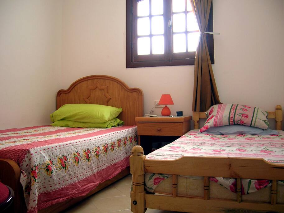 The bedroom with 2 large single beds.