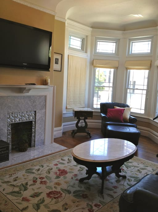 Living room with bay window and second flat screen TV with cable seats 6