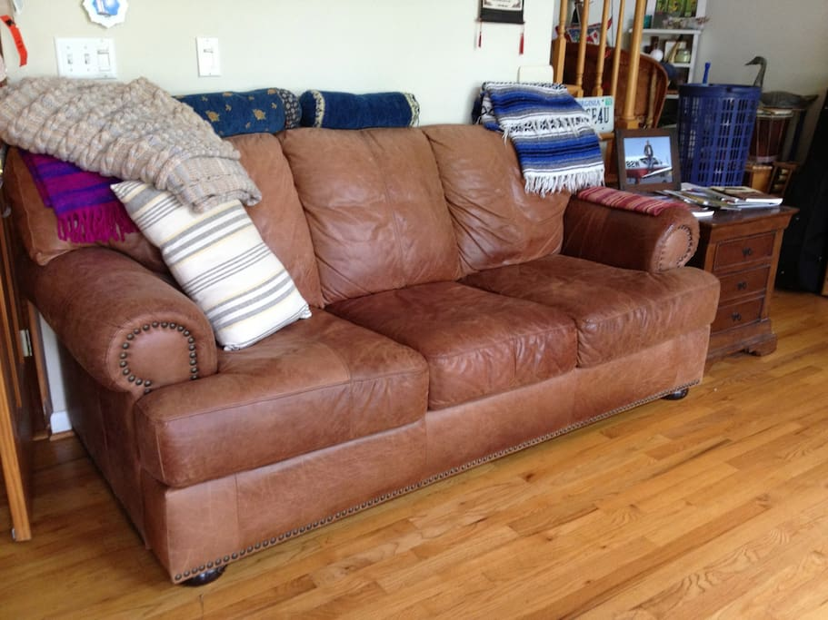 Queen Size Leather Sofa folds out into bed  in Vaulted Living Room,overlooking deck and tub...