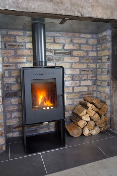 There is a comfy seating area so you can snuggle up close to the wood burner!