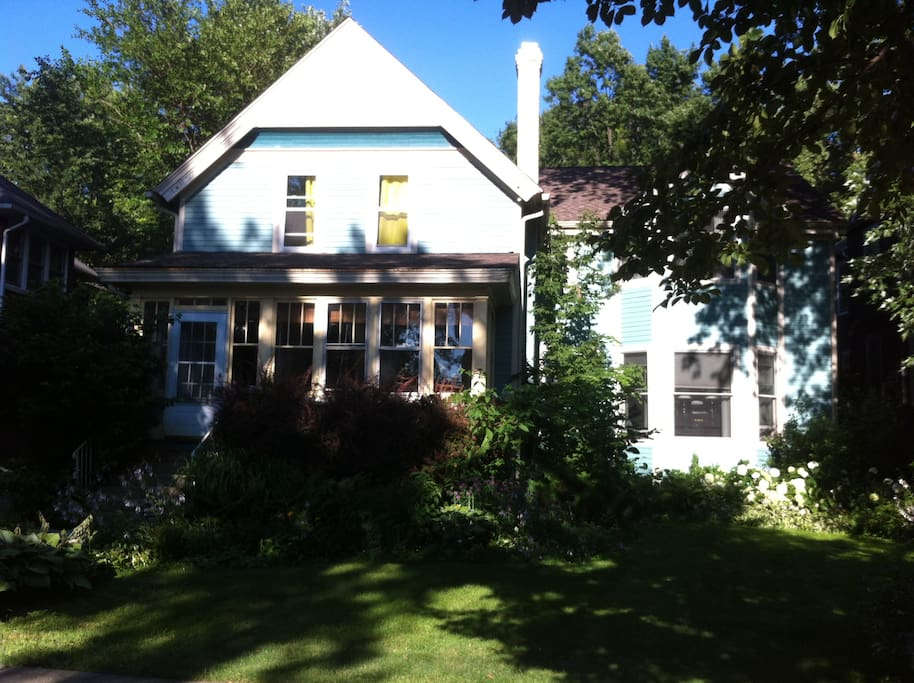 Wonderful century old renovated farmhouse conveniently located in Evanston, with blooming perennial garden in front.