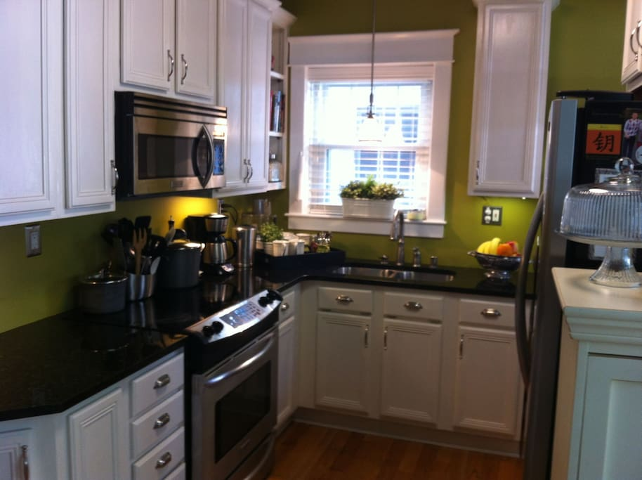 Kitchen with all kinds of gadgets, granite counters and stainless appliances.  Help yourself to staples, and the fridge has a space cleared for you.