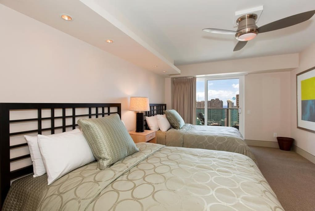 Second Bedroom with 2 double size beds, private balcony and ocean views.