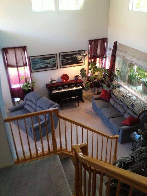 View from upstairs into the living room - that's Dannie's piano -- and yours too, if you play!