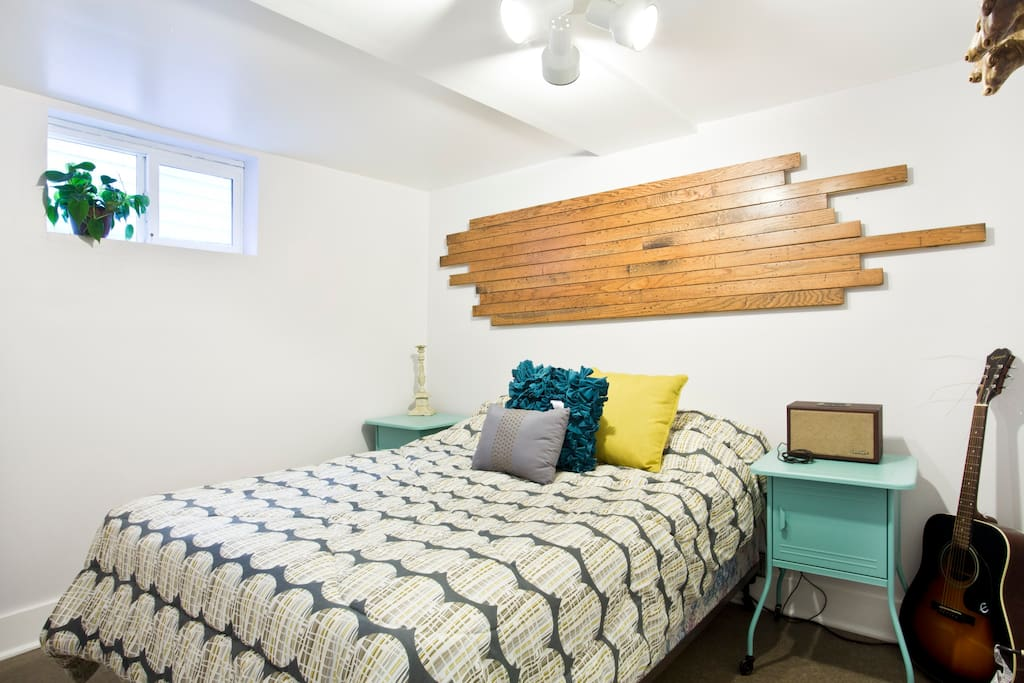 Full-size bed, reclaimed oak flooring piece, stereo with aux jack, lots of electrical outlets