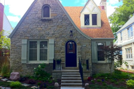 MKE's 1st suburb: 15 mins to downtown, museums, universities, stadium, events. Home w/wood, leaded glass. Upstairs suite: large BD w/full bed, a/c, closet; living room/kitchenette, bath, laundry, wi-fi. Bus on corner. Pls don't apply unless verified!