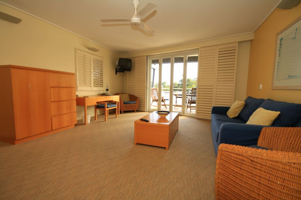 Lounge room, balcony over looking water. Two Extra pull out beds