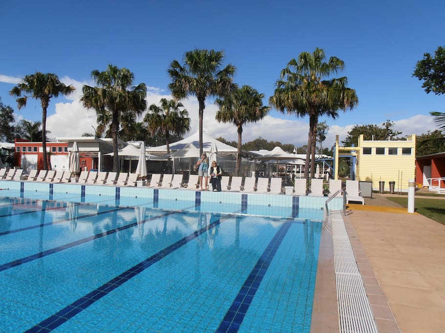 Olympic size swimming swimming pool for adults and an extra large kids pool with shade.