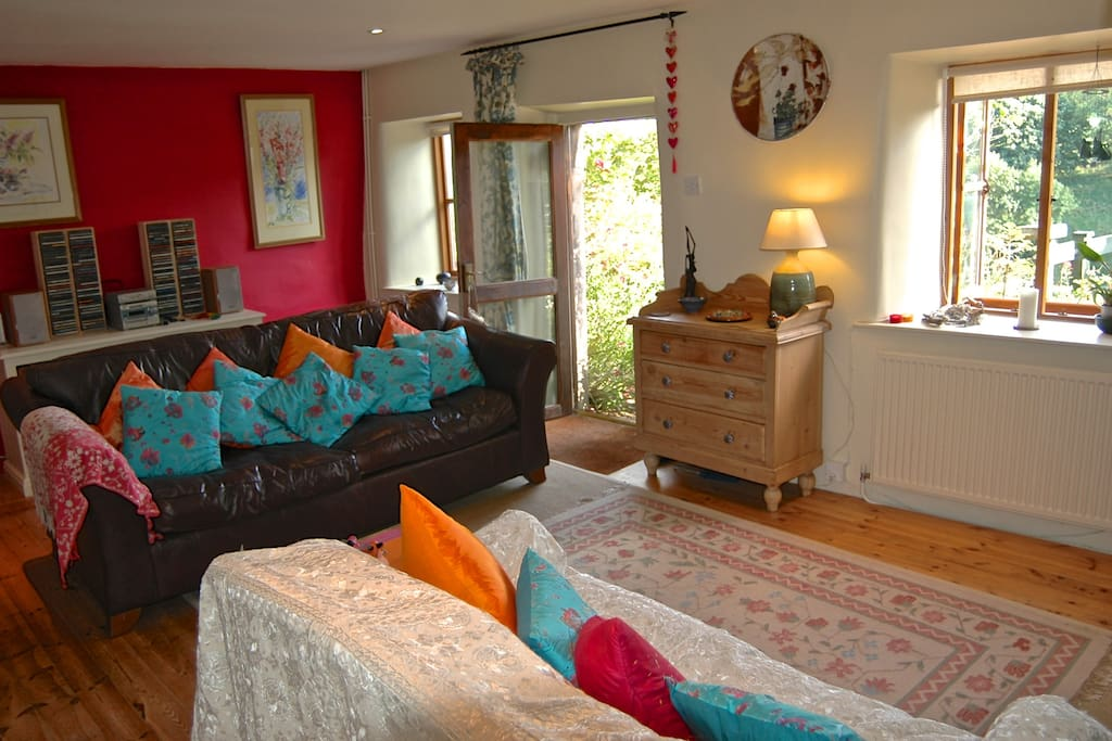 The sitting room with its vibrant warm colours