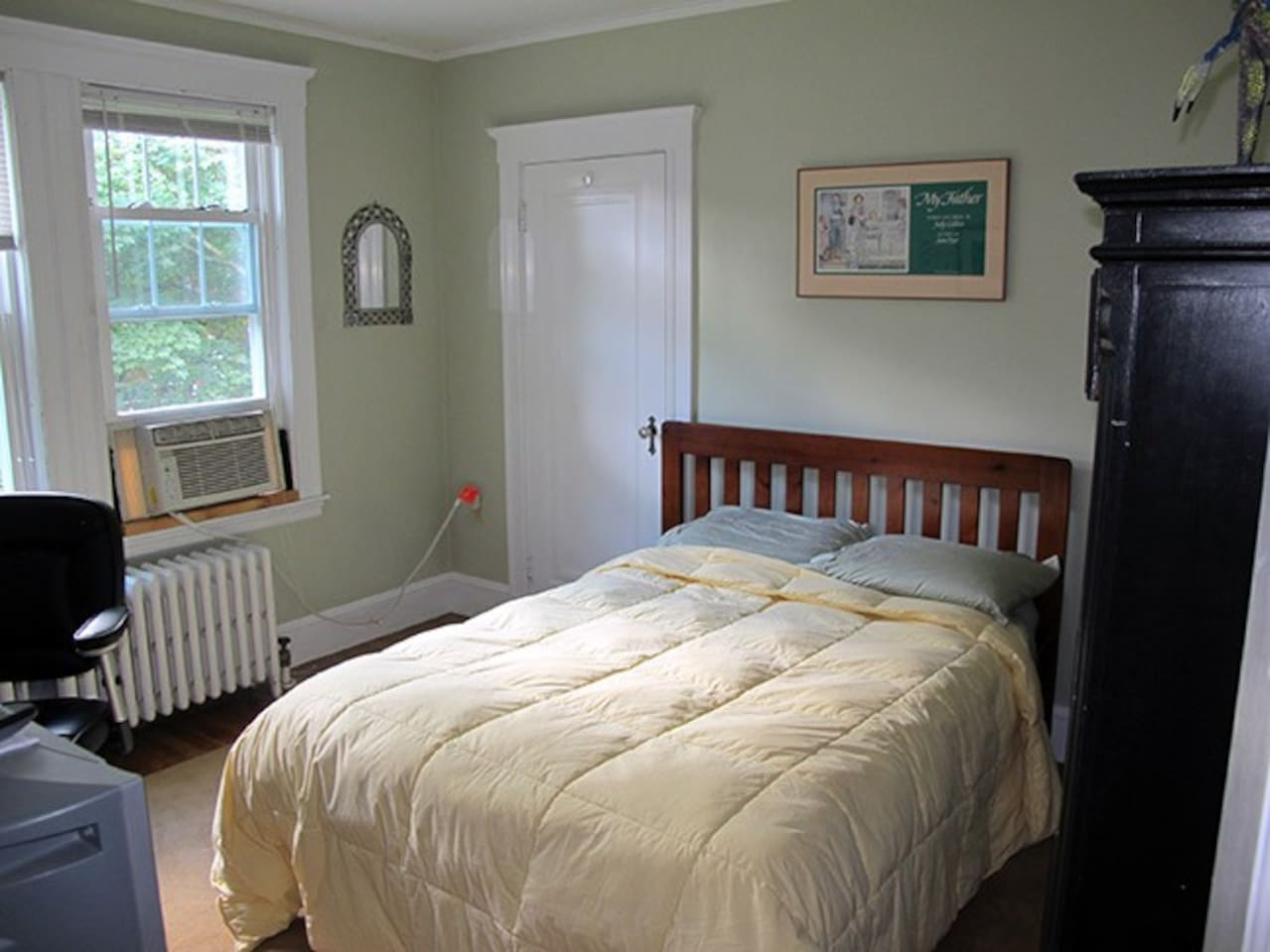 "Your room includes ""full"" size mattress on a wood-frame bed, tall bureau and AC in summertime."
