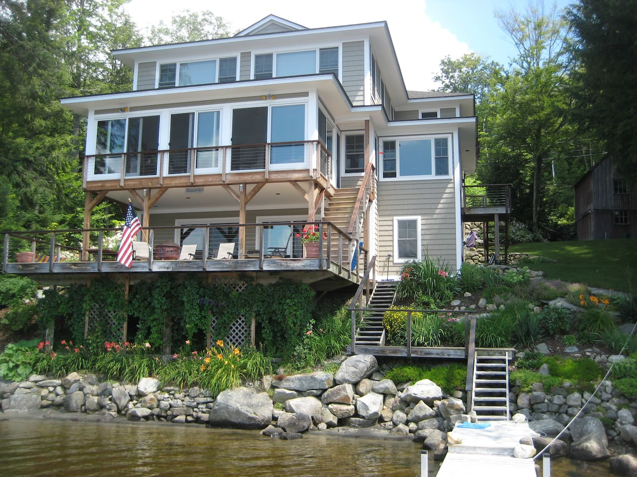 Three story home right on the water with 110 ft of waterfront and dock.