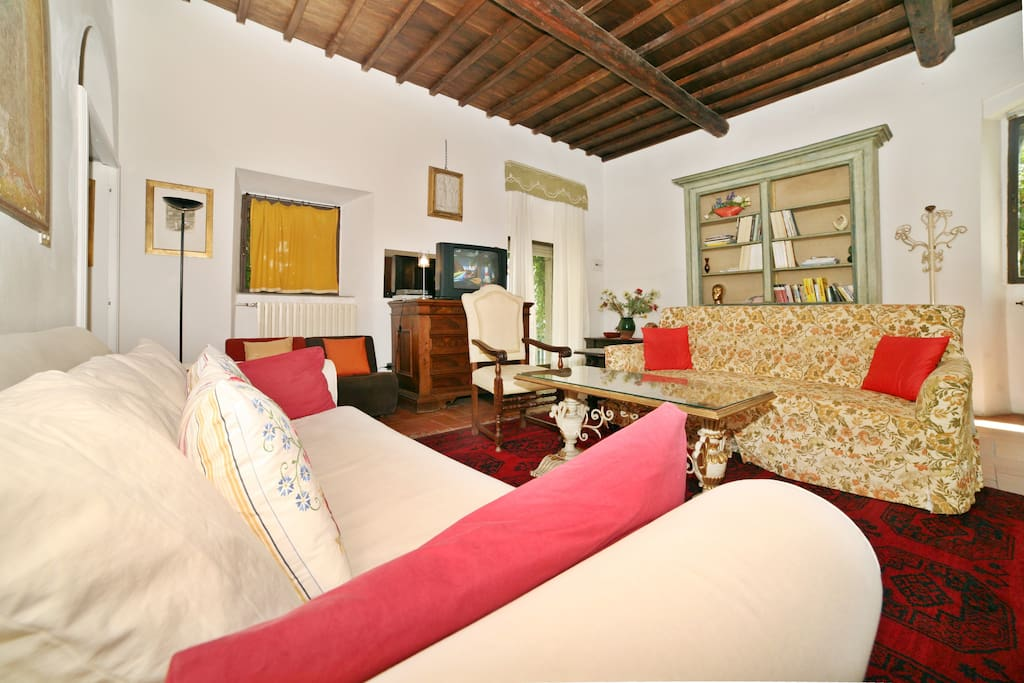 Spacious Living room decorate with antiques. Satellite TV, video and library books, board games