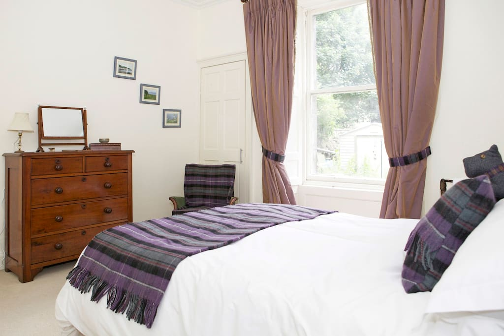 Large double bedroom with a Scottish feel