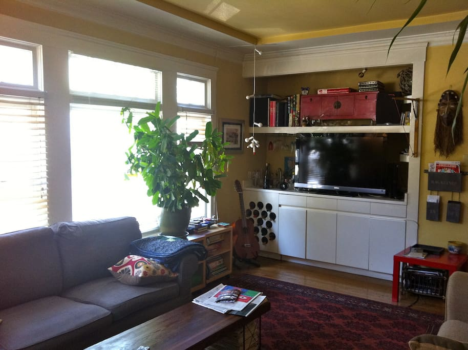 living room with wet bar and large tv