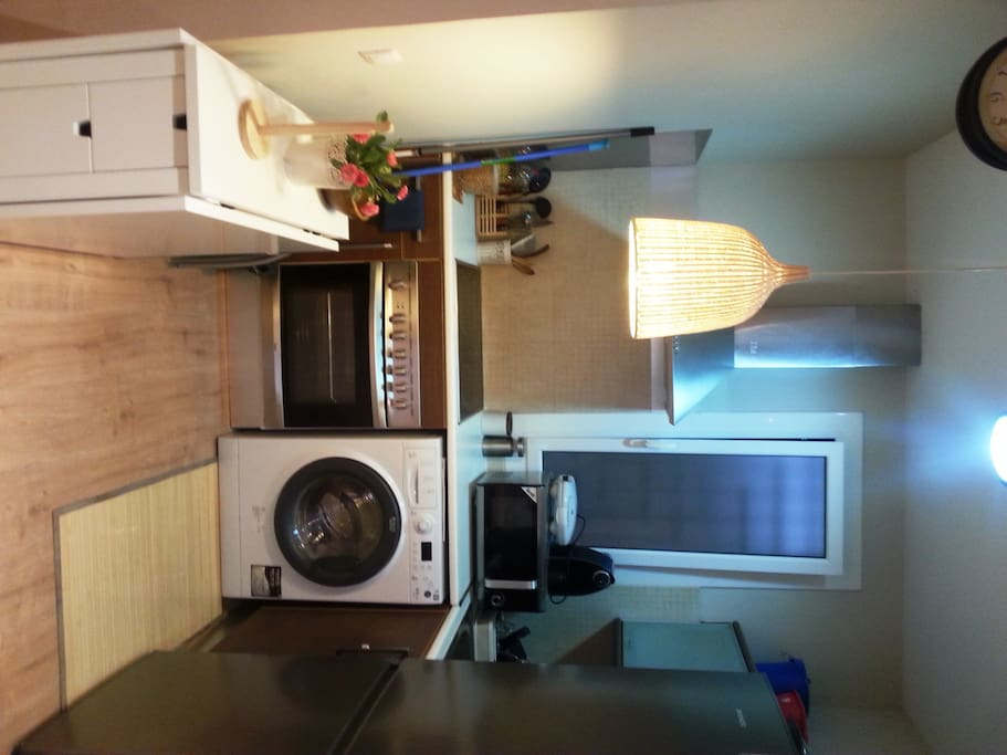 Fully equipped kitchen with oven, microwave and everything you could need to cook during your stay.