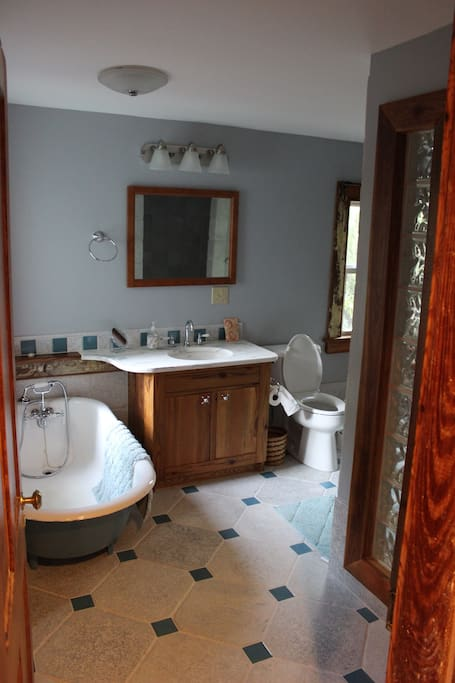 Bathroom with clawfoot tub and custom details throughout.