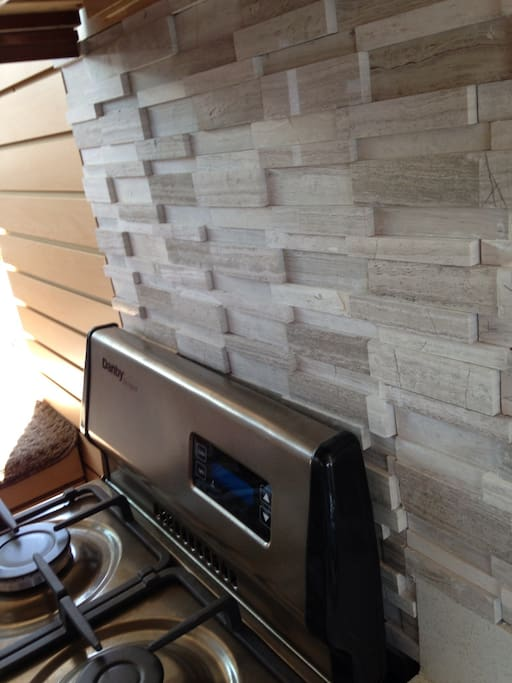 3D Illusion Wooden Subway Bricks backsplash adds to the contemporary feel