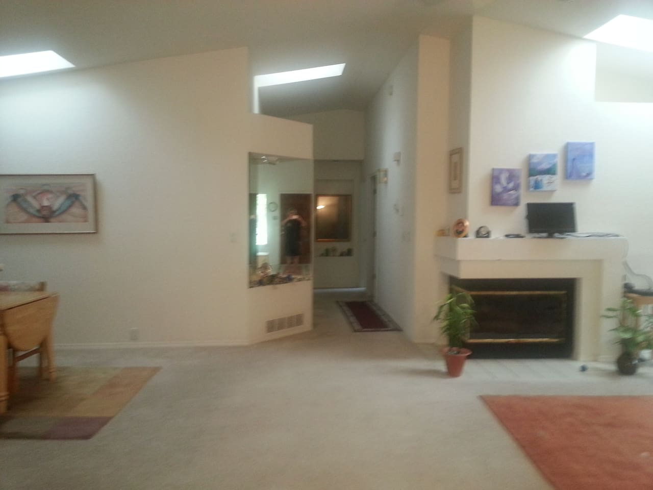 Spacious Living area with open floor plan to kitchen, dining room, private patio, bedrooms, & garage.