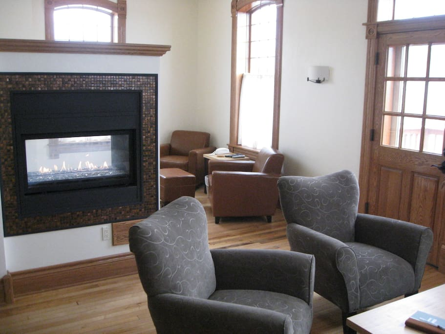 Living area features see-through gas fireplace