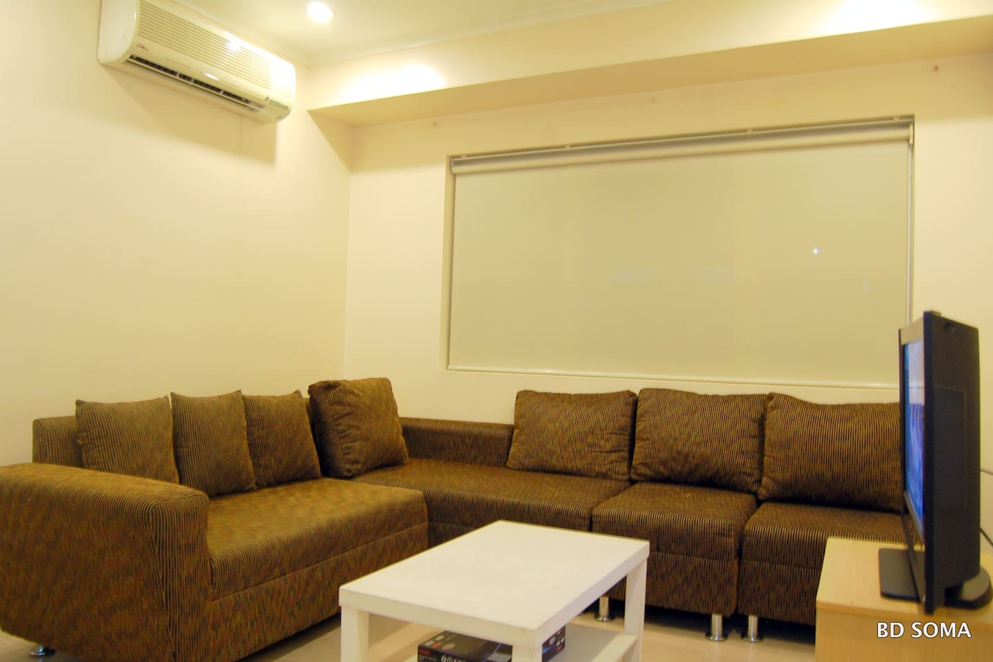 Fully air-conditioned spacious living area with LED TV
