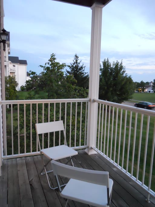 Patio overlooks a large green space and quiet, residential neighbourhood.