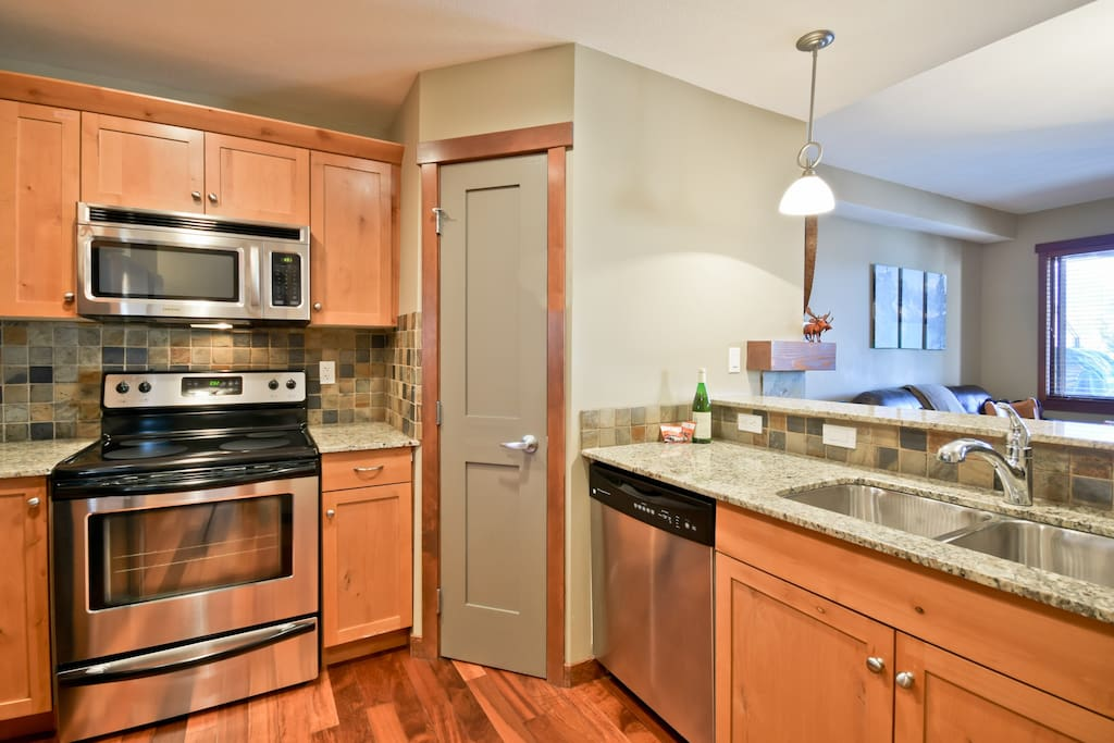 Granite and stainless steel throughout this well-equipped kitchen