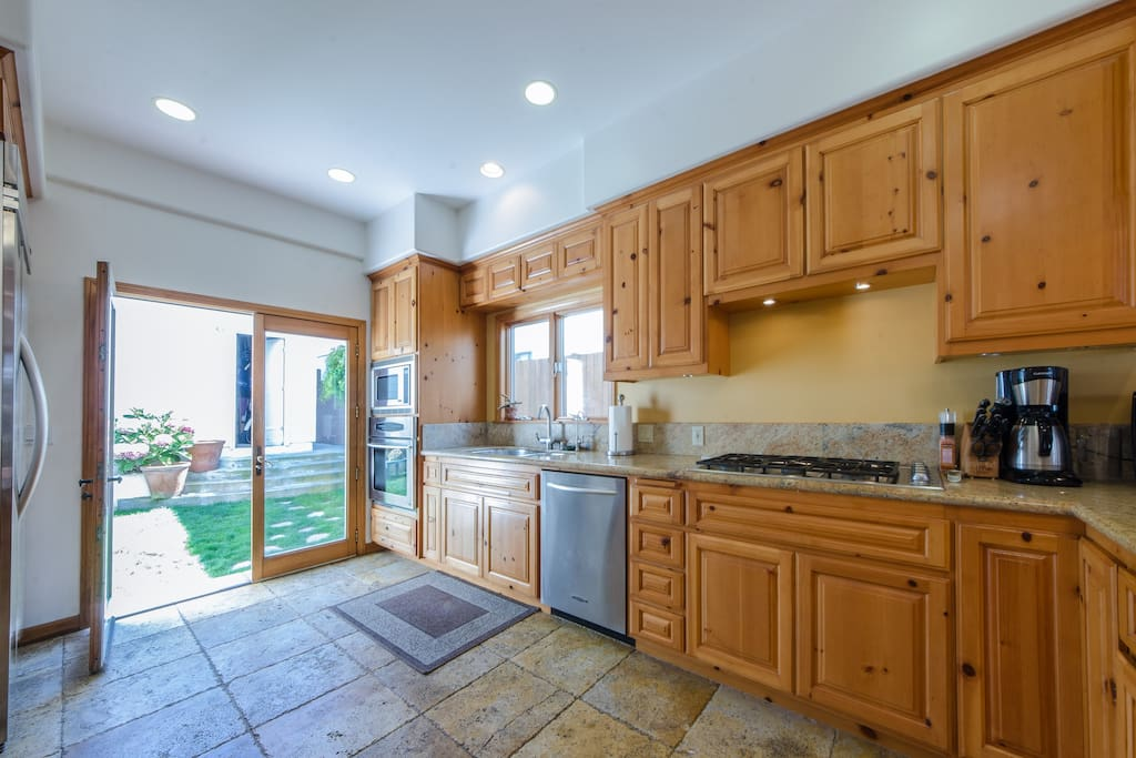 Spacious Family Kitchen Opens to Backyard