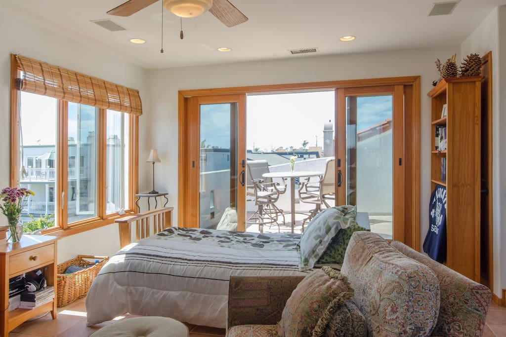 Full size Futon Bed Comfortably Sleeps Two - Opens to Ocean View Deck