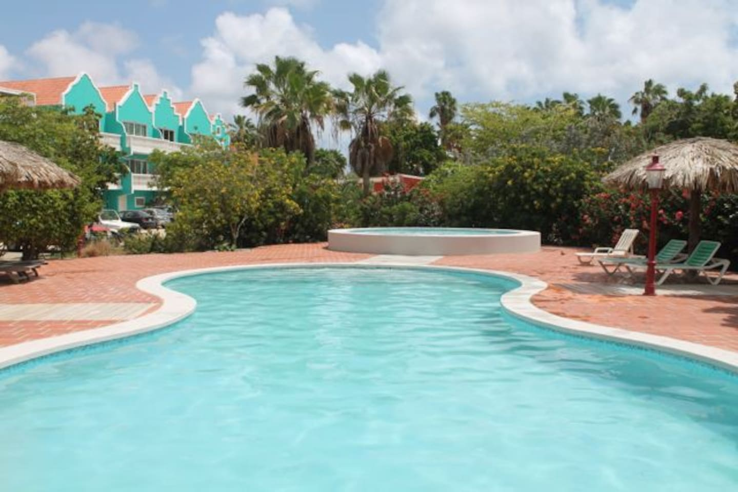 Your Breezy Bonaire Studio Apartment is located in the Teal building on the second of three floors. It is Seen here from the pool.