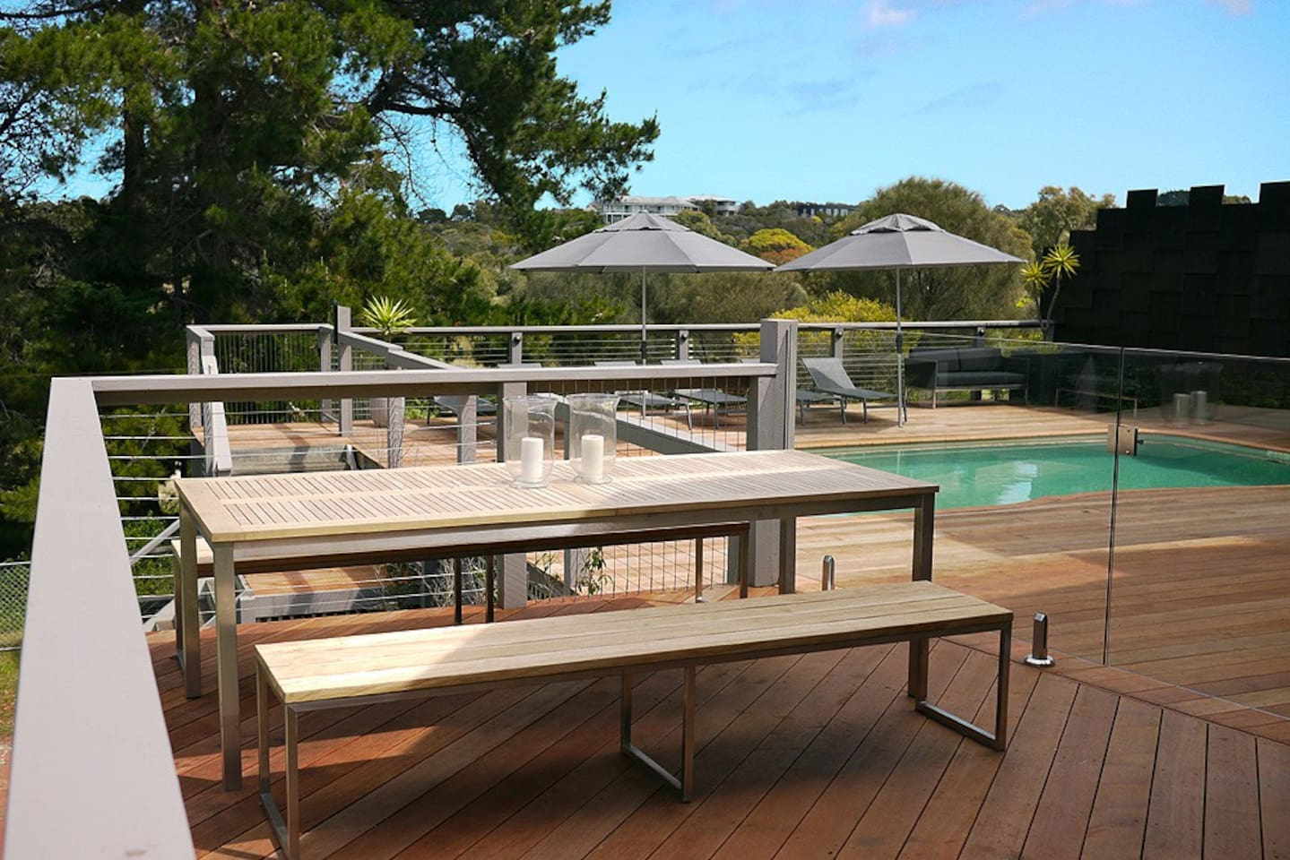 Outdoor dining area overlooking pool, tennis court and golf course