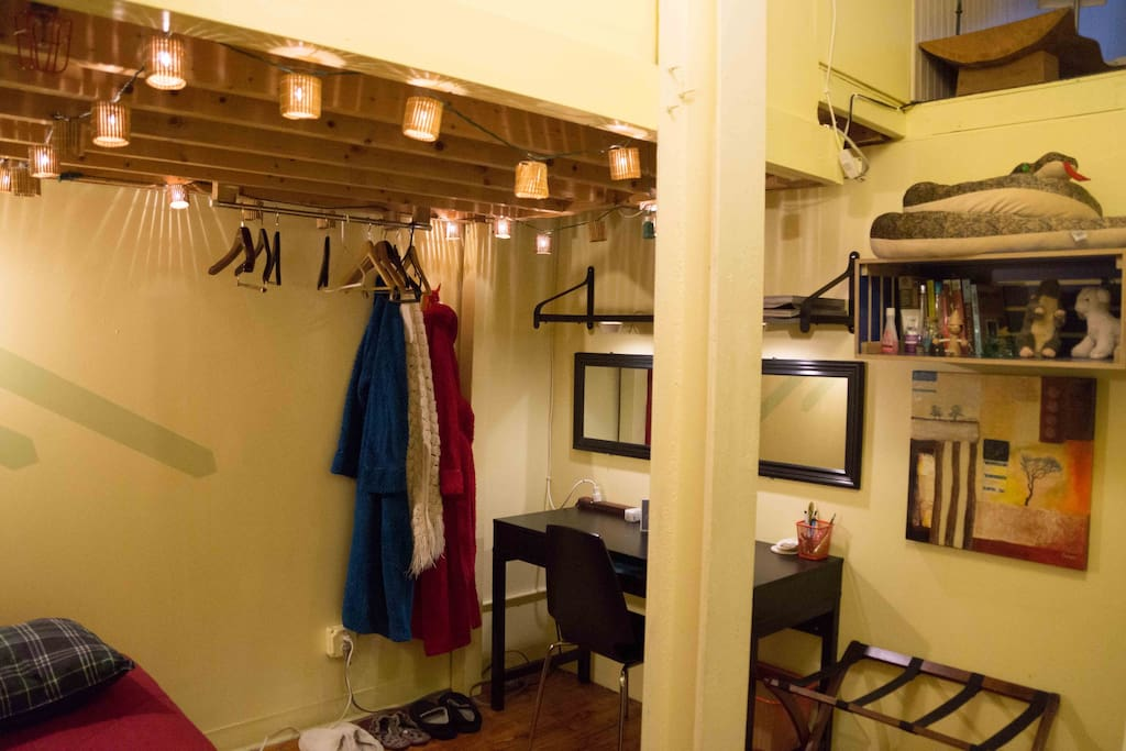 your room! On the picture you see rack for hanging clothes, luggage rack. Also we give three robes and slippers for winter guests