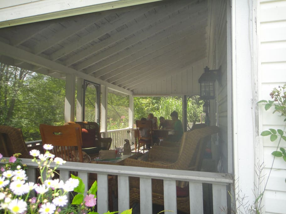 Classic screened in veranda, for eating, reading, or watching the world go by