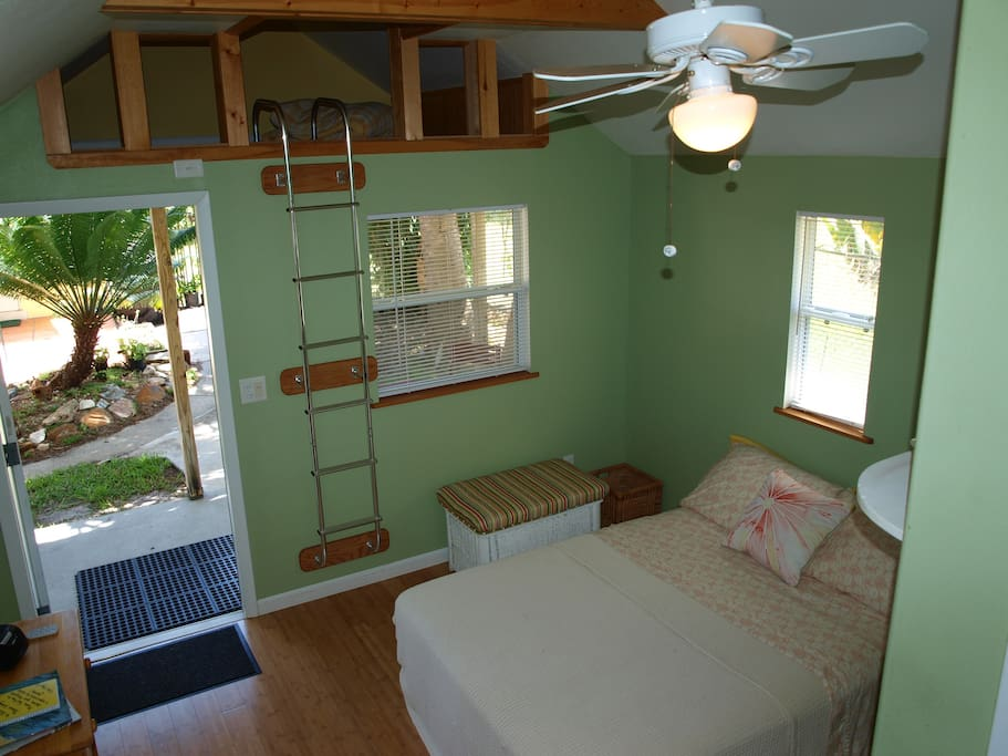 View from corner of the cottage shows the loft above; small air mattress can be provided for appropriately aged child.