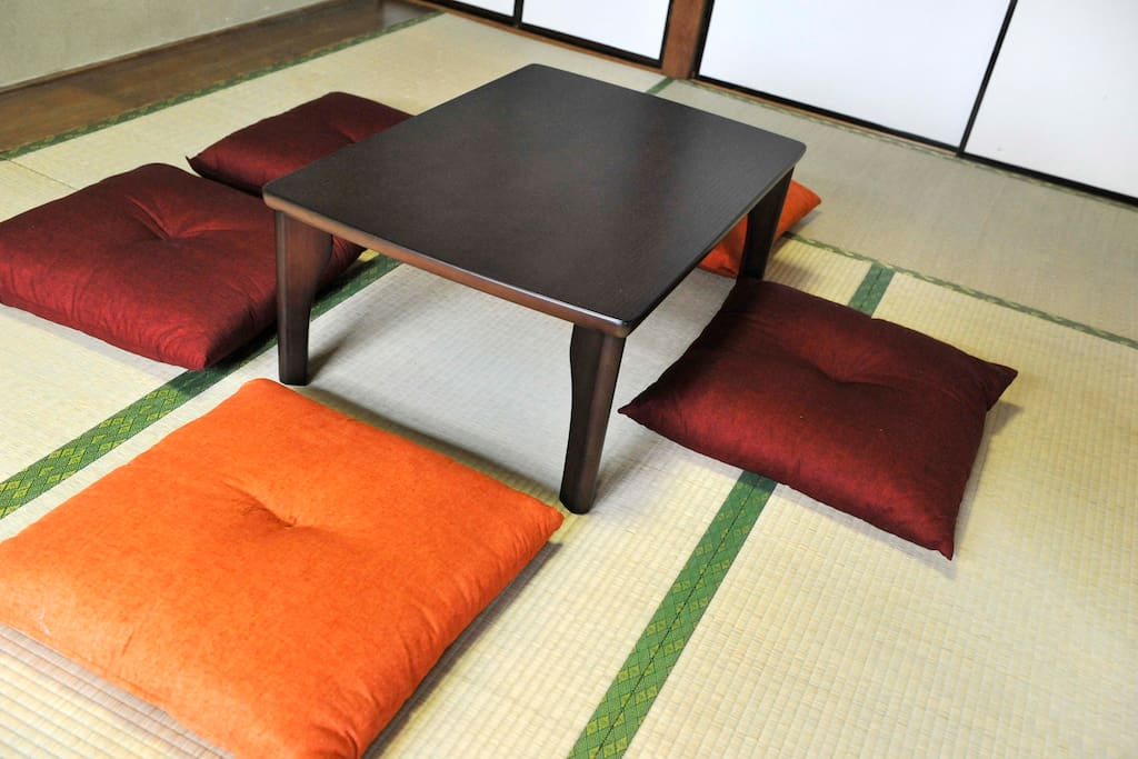 Japanese tatami room - sit down and relax on the Japanese tatami mats - we hope you will have some wonderful conversations here - at night simply put the table away and pull out the Japanese futons to sleep up to four people in this room