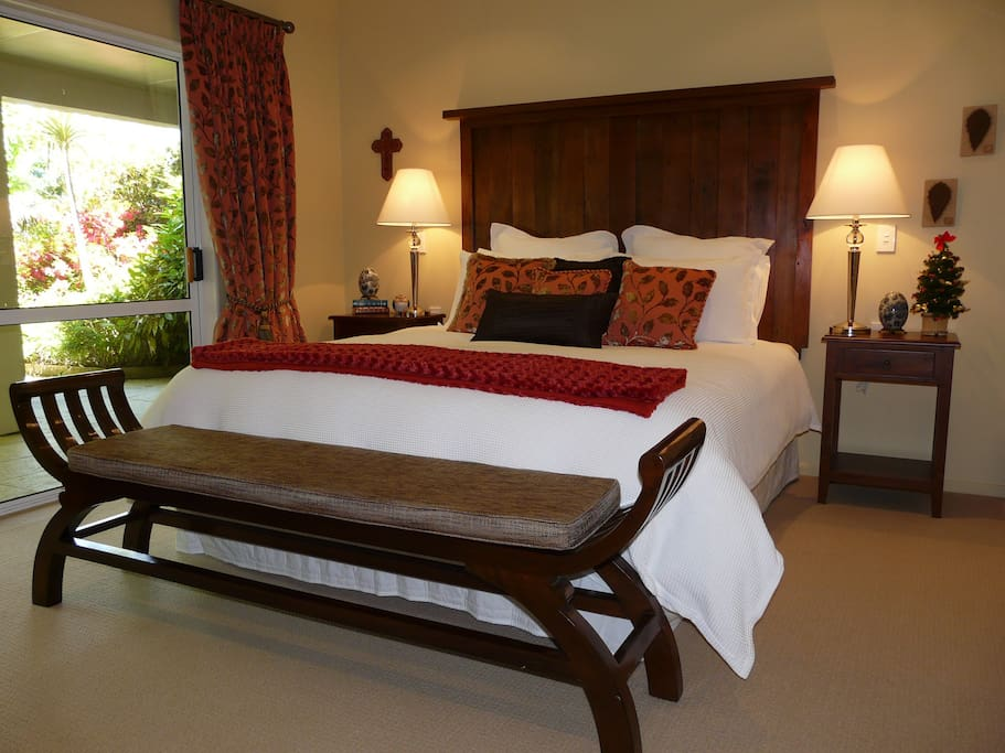 Romantic Tongariro room, superior king double bed, opens out onto patio and into the garden.